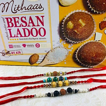 Four Lovely Rakhi Set With Besan Laddu: Send Devotional Rakhi to Australia