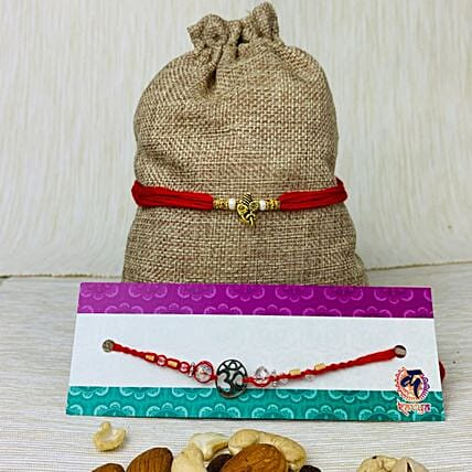 Om And Ganpati Two Rakhi Set With Dry Fruit:
