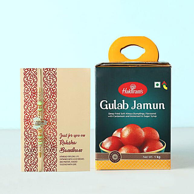 Green Ganesha Rakhi And Gulab Jamun Combo: Rakhi to Germany from India