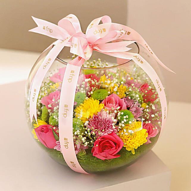 Colourful Flowers in Fish Bowl: Fresh Flower Arrangement