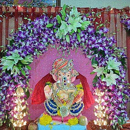 Orchids and Asiatic Lilies Arc Decoration: Ganesh Chaturthi Gifts
