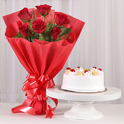 Red Roses & Pineapple Cake Combo: Women's Day Flowers & Cakes