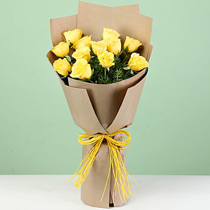 12 Perky Yellow Roses In Brown Paper: