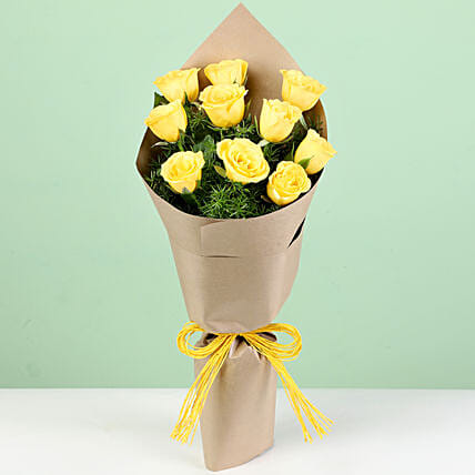 10 Peppy Yellow Roses In Brown Paper: Yellow Flowers