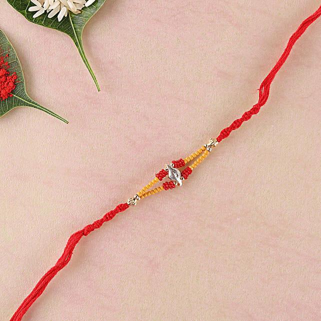 Hand Crafted Red Elegant Rakhi Thread: Send Single Rakhi to Portugal