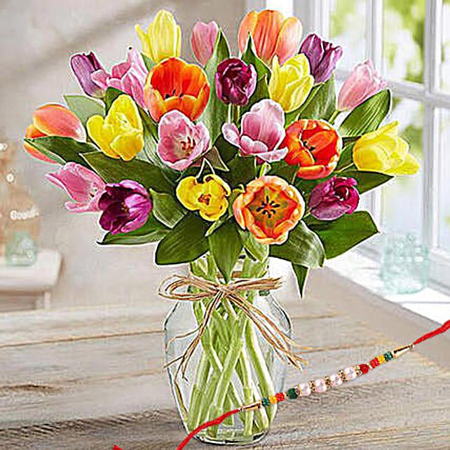 Colourful Tulips In Glass Vase With Rakhi: Rakhi With Flowers to Singapore