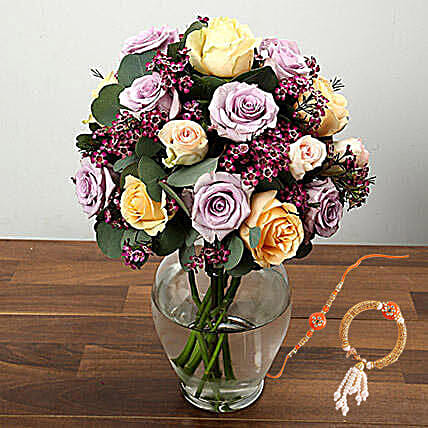 Mixed Rose And Wax Flower Arrangement In Glass Vase With Rakhi: Rakhi With Flowers to Singapore