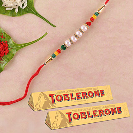Pearl Rakhi And Toblerone Combo: Best Selling Gifts in Singapore