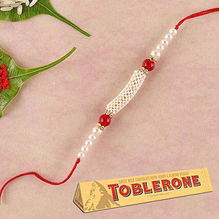 Fancy Rakhi And Toblerone Special Combo: Rakhi Gifts for Brother to Singapore