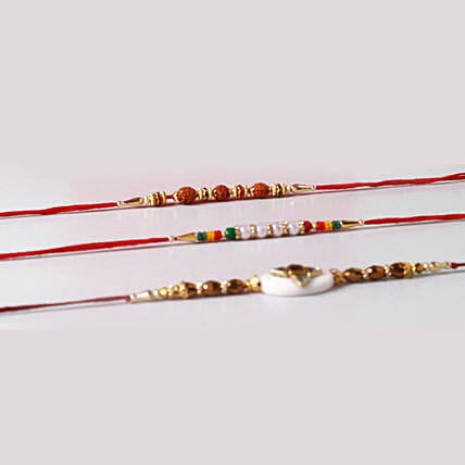 Set of 3 Vibrant Rakhis In Red Box: Set of 3 Rakhi to Singapore