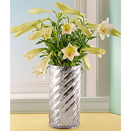 St Joseph Lilies In A Silver Twirl Vase: Lilies to South Africa