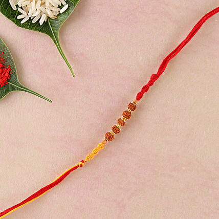 Yellow Red Rakhi Thread with Rudraksha: Devotional Rakhi to UK