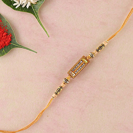 Diamond on Wooden Rakhi Thread: Send Rakhi to Newcastle