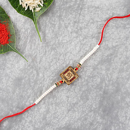 Hand Crafted Aum Wooden Rakhi: Rakhi to Newcastle