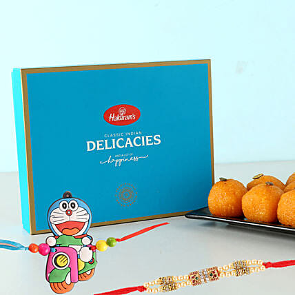 Motichoor Laddu And 2 Rakhis Festive Combo: Rakhi for Kids to UK