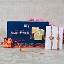 Send gifts to uk online same day gift delivery in uk ferns n petals family rakhi with soan papdi sweet negle Choice Image