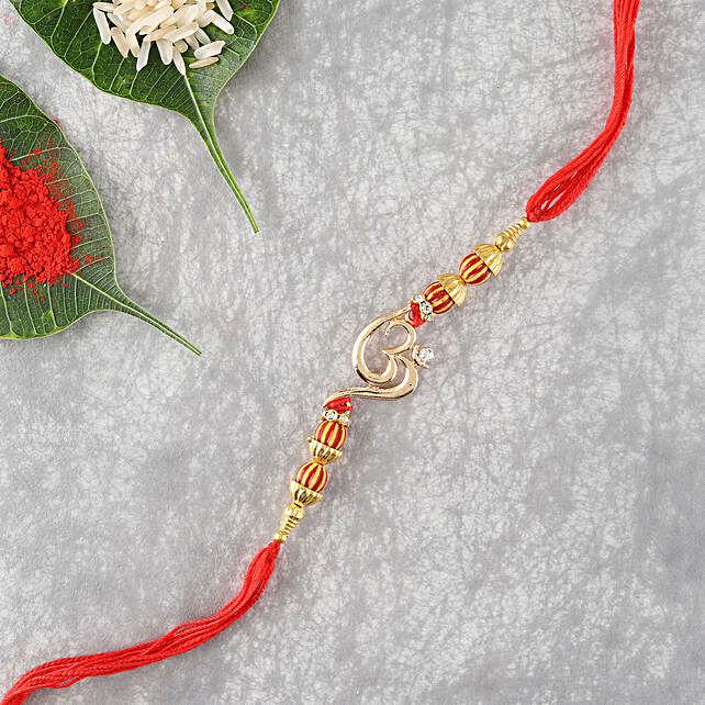 Stone Studded Designer Om Rakhi: Devotional Rakhi Delivery in USA