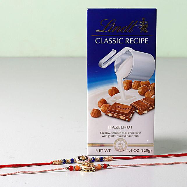 Lindt Classic With Set of 2 Rakhis: Rakhi With Chocolates to USA