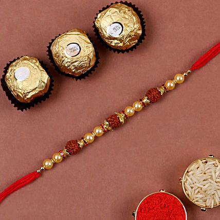 Golden Red Rudraksh Rakhi And 3 Pcs Ferrero Rocher: Send Rakhi to USA
