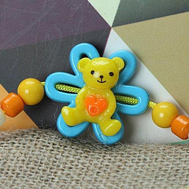 Cute Little Teddy Rakhi WES: Rakhi Gifts to West Indies