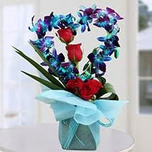 Heart-Shaped Arrangement of Blue Orchids & Red Roses