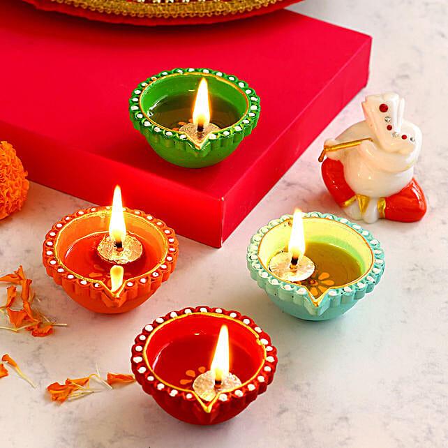 4 Colourful Diyas With Orange & White Ganesha Idol:Send Diwali Gifts to Australia