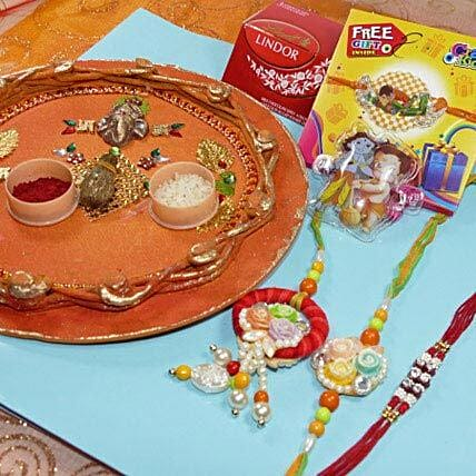 Outstand Rakhi Set Of Four Thali With Lind Lindor