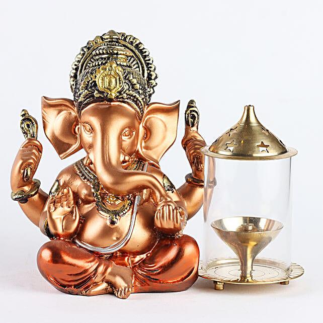 Golden Ganesha Idol With Glass Akhand Diya