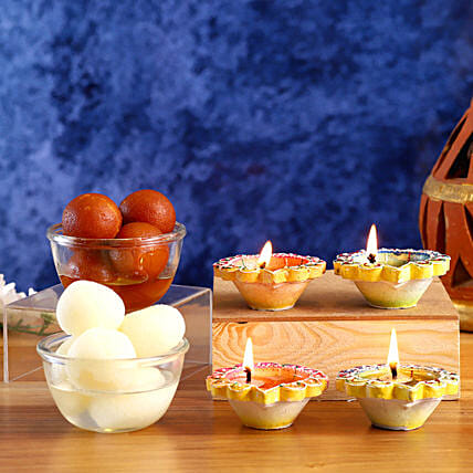 Designer Diyas With Almonds And Sweets