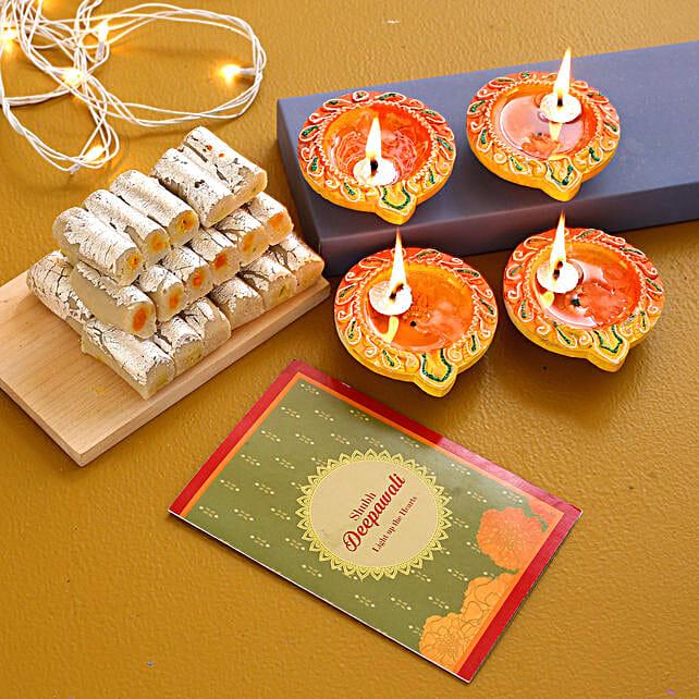 Diwali Greetings With Diyas And Kaju Roll