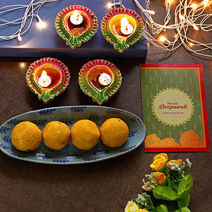 Floral Diyas With Greeting Card And Besan Laddoo