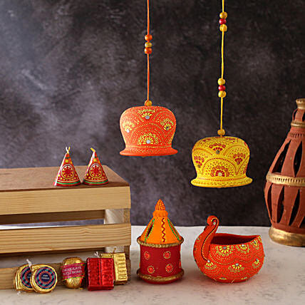 Diyas With Bells And Cracker Shaped Chocolates:Send Diwali Gifts to Canada