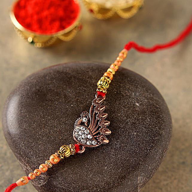 Elegant Golden Peacock Rakhi