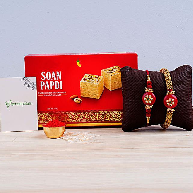 Red Pearl Rakhi Set And Soan Papdi