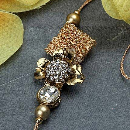 Delightful Antique Rakhi ISR
