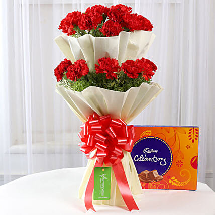 carnations wrap in white bouquet with chocolates