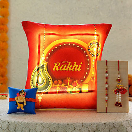 3 rakhis with printed cushion