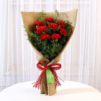 8 Red Carnations Bouquet in Jute:Flowers for Gudi Padwa