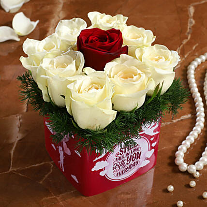 white rose in vase arrangement for vday