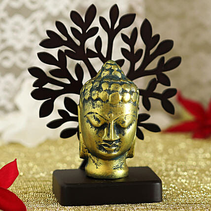 Antique Face Of Buddha Idol Under A Tree