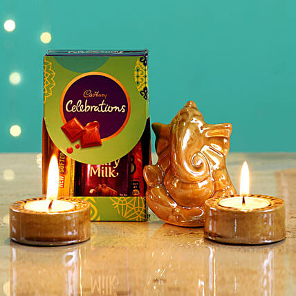 Beige Ganesha Idol & Candles With Cadbury:Buy Cadbury Chocolates