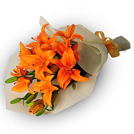 Bright Side of Life - One sided Bunch of 6 stems of Orange asiatic lilies in paper packing.