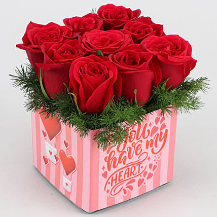red rose in vase arrangement for vday