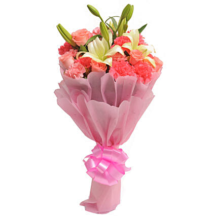 Carnations N Lilies - Bunch of 20 Mix flowers in pink paper packing.