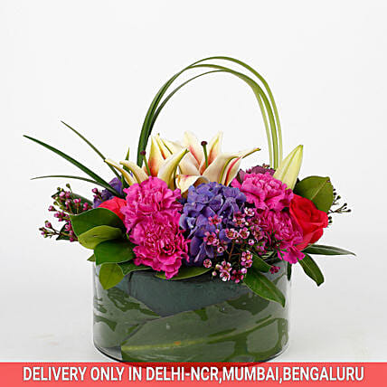 celebration of roses and carnation with vase