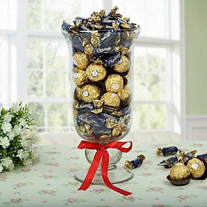 Cadbury chocolairs gold candies and ferrero rocher in a samadhan  vase wrapped with red ribon2