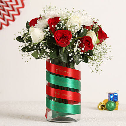Christmas Roses Bunch In Vase