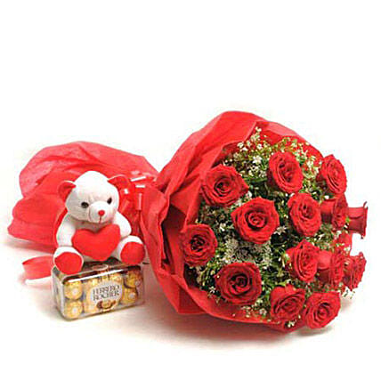Classic Beauty - Bunch of 15 Red Roses in a paper packing with 200gm Ferrero rocher chocolate box & Cute soft toy.