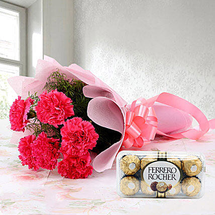 Cute Hamper - Bunch of 6 Baby Pink Carnations with 200gm Ferrero rocher chocolates box.
