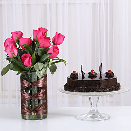 pink roses in attractive vase with truffle cake combo